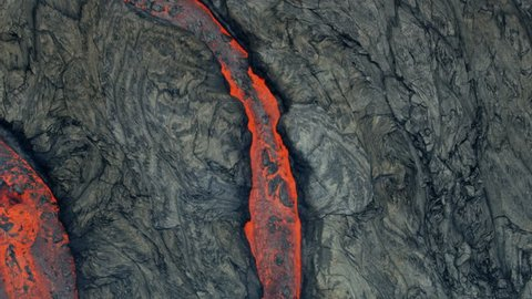 Aerial view of textured lava rock solidifying and cooling red hot lava rivers of liquid volcanic material pouring from the earths crust RED WEAPON