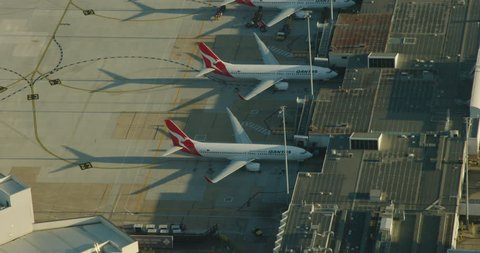Melbourne Australia - March 2018: Aerial sunrise view Qantas aircraft for visitors and business commuters parked at Melbourne airport terminal Tullamarine Victoria Australia