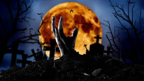 Zombie hand comes out of the grave and bats fly. Graveyard background