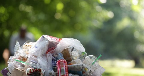 LONDON, ENGLAND - MAY 28, 2015 London Park with Trash Can Garbage Dumpster with Plastic Food Bags and Metal Box