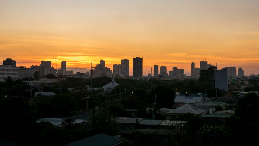 METRO MANILA, PHILIPPINES - CIRCA MARCH 2018: Time-lapse view on the houses of Makati from a top of a skyscraper during sunset circa March, 2018 in Metro Manila, Philippines.  | Shutterstock HD Video #1018482598