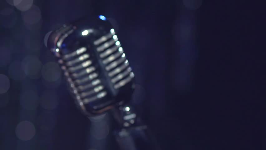 Singing Woman with Retro Microphone. Karaoke. Beauty Glamour Singer Girl. Vintage Style. Song. Slow motion 240 fps. High speed camera shot. Full HD 1080p