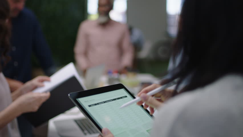 Business people meeting team leader woman using tablet computer presenting creative ideas multi ethnic group working together brainstorming project management strategy in office boardroom | Shutterstock HD Video #1018525468