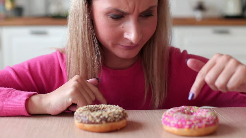 Woman wants to eat donuts at home | Shutterstock HD Video #1018528858