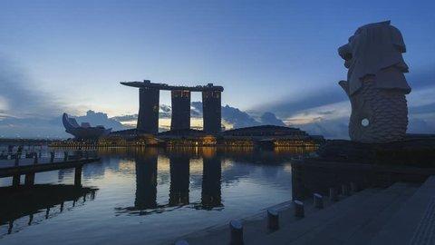 Marina Bay, Singapore - October 2018 - Timelapse of sunrise moment at Merlion Park facing Marina Bay Sands hotel. Motion zoom in