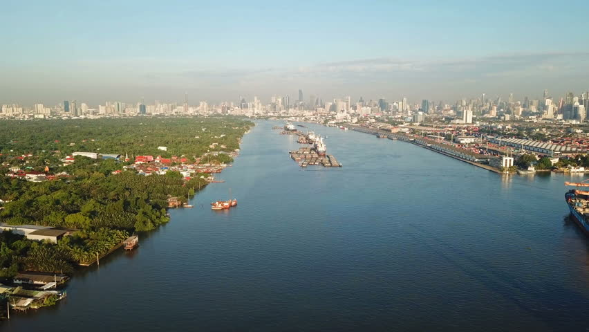 Aerial view of Chao Phraya River, Bangkok Downtown. Financial district and business centers in smart urban city in Asia. Skyscraper and high-rise buildings at noon. | Shutterstock HD Video #1018734988