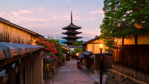 Kyoto, Japan. A sunrise timelapse with a view of To-ji temple and a row of old japanese shops and houses in Kyoto, Japan. Time-lapse, zoom in