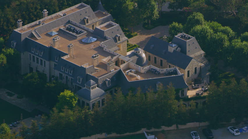 Aerial view of Beverly Hills mansions on a sunny day in Los Angeles, California. Shot on 4K RED camera.