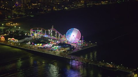 Aerial view of Santa Monica pier on a clear night in Los Angeles, California. Shot on 4K RED camera.