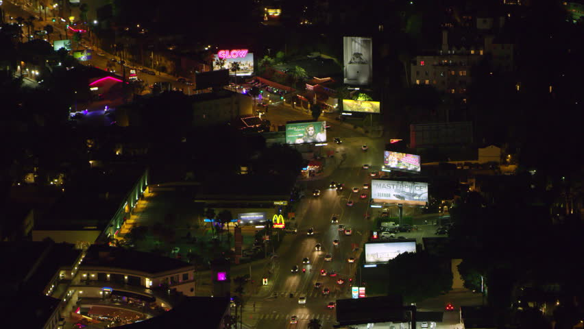 LA, California, USA, circa 2018: Aerial view of city billboards on a clear night in Los Angeles, California. Shot on 4K RED camera. | Shutterstock HD Video #1019022658