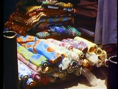 ALEXANDRIA, EGYPT, 1977, Cotton Market, wide shot, bolts of cloth