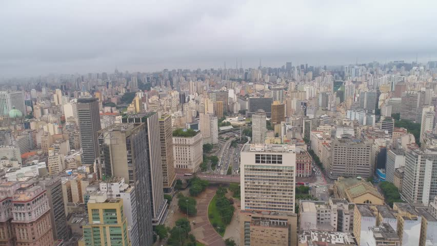 SAO PAULO, BRAZIL - MAY 3, 2018: SAO PAULO, BRAZIL - MAY 3, 2018: Aerial View of the city centre Mail square, residental and business buildings in downtown from above. Drone shot in 4K #1019117818