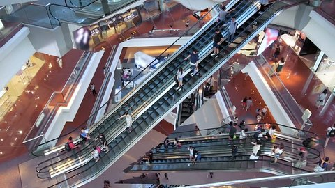 HONG KONG, CHINA - CIRCA NOVEMBER, 2018: Time lapse escalators in modern shopping mall crowd of people. Very busy full of clients mall complex. Consumption concept