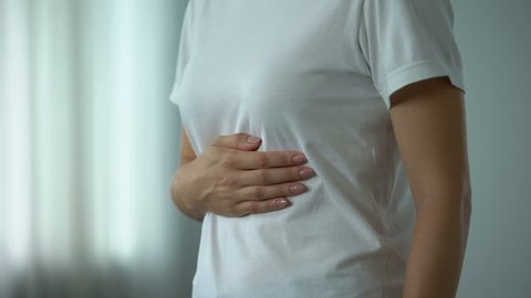 Female feeling stomachache, suffering from peptic ulcer, unhealthy eating result