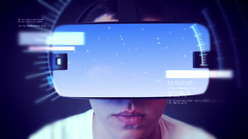 Young man wearing VR headset and watching business and economy related graphics. | Shutterstock HD Video #1019252488