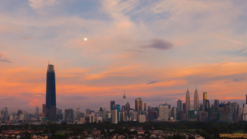 Time lapse: Kuala Lumpur city view during dawn at sunrise overlooking the city skyline with golden light on the city buildings and moonset. Malaysia. Full HD. 4k available. Zoom in motion timelapse | Shutterstock HD Video #1019286658