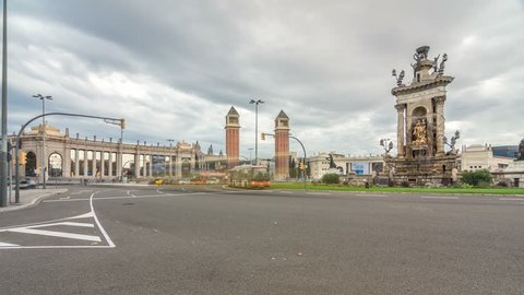 Cityscape view of Placa d'Espanya or Spain square, with the Venetian Towers and the National Art Museum timelapse hyperlapse. Traffic on circle roundabout