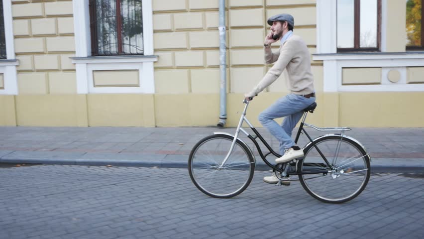 Young stylish male with retro bicycle riding on the streets in sunny day, portrait modern businessman with cellphone | Shutterstock HD Video #1019363878