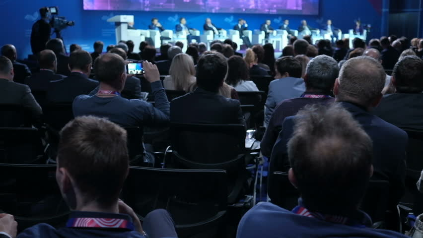 People on the forum on business development. Hall is full. View from the back of auditorium with people at a conference or presentation, master class. International economic business forum | Shutterstock HD Video #1019501278