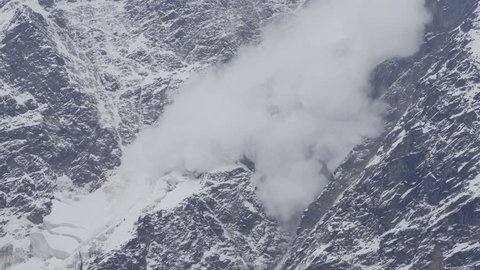 An avalanche in the mountains. Caucasian ridge, avalanche descended on the glacier