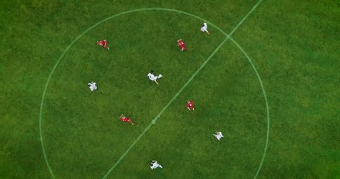 Aerial Top Down View of Soccer Field and Two Professional Teams Playing. Energetic Game in the Middle of the Field. Important Match on International Championship