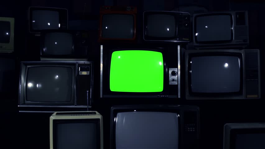 "80s TV Green Screen with Many 80s Tvs. Dolly In. Night Tone. Ready to Replace Green Screen With any Footage or Picture you Want. You Can Do it With ""Keying"" (Chroma Key) Effect in After Effect. 