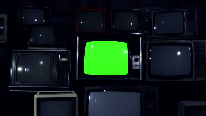 """80s TV Green Screen with Many 80s TVs. Dolly In. Night Tone. Ready to Replace Green Screen With any Footage or Picture you Want. You Can Do it With """"Keying"""" (Chroma Key) Effect in After Effect.   Shutterstock HD Video #1019622868"""