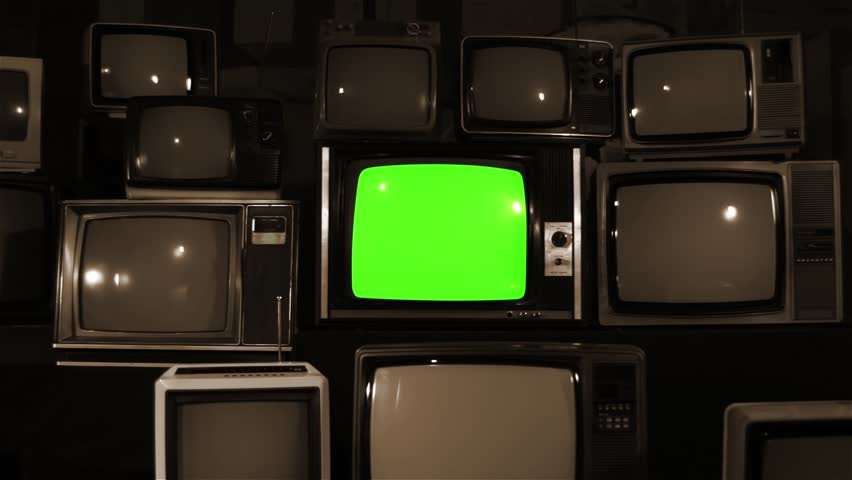 """Old TV Green Screen over 80s Tvs. Sepia. Dolly In. You can Replace Green Screen with the Footage or Picture you Want with """"Keying"""" effect in After Effects (check out tutorials on YouTube).  