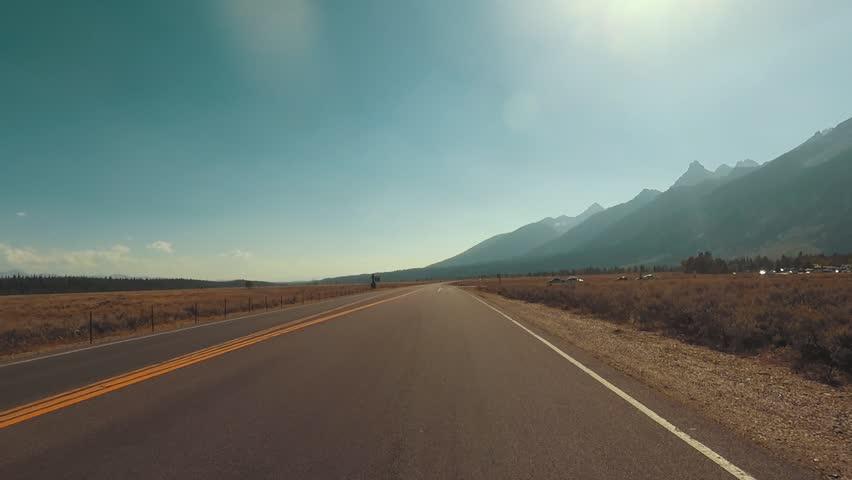 Driving a Car through Grand Teton park, back light, Point of View - Mounted 2.7k Ultra HD footage | Shutterstock HD Video #1019719948