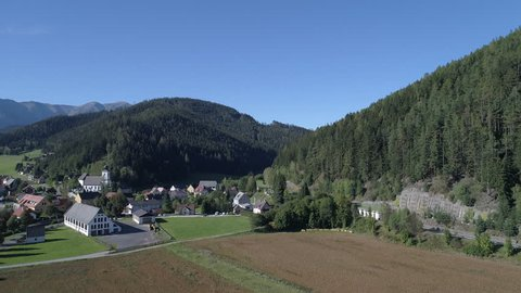 Austria Mountains Aerial Farming Community village and Pine Trees