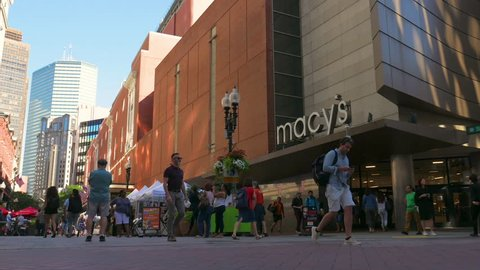 Boston, MA / USA - 07.13.2018: Macy's Shopping Mall with crowds of people walking and american flag waving, Boston