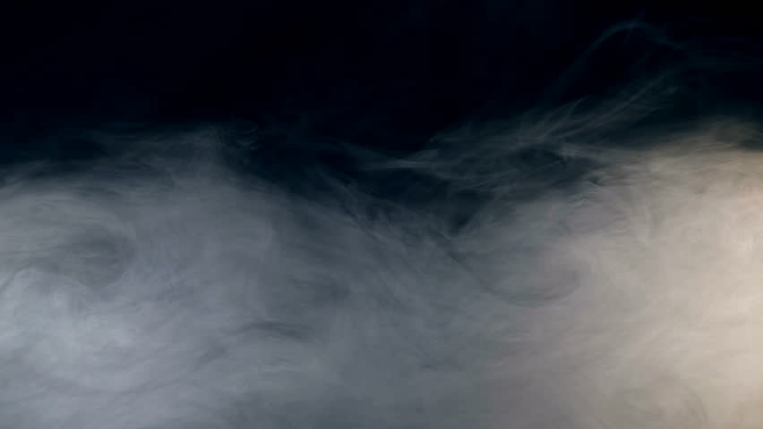 Thick layers of smoke spreading against the dark background | Shutterstock HD Video #1019855038