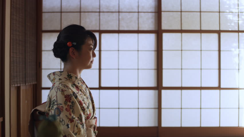 Male tea master opening the door and bowing at a female in kimono in a room in a traditional Japanese home with soft day lighting. Medium shot on 4k RED camera. | Shutterstock HD Video #1019861638