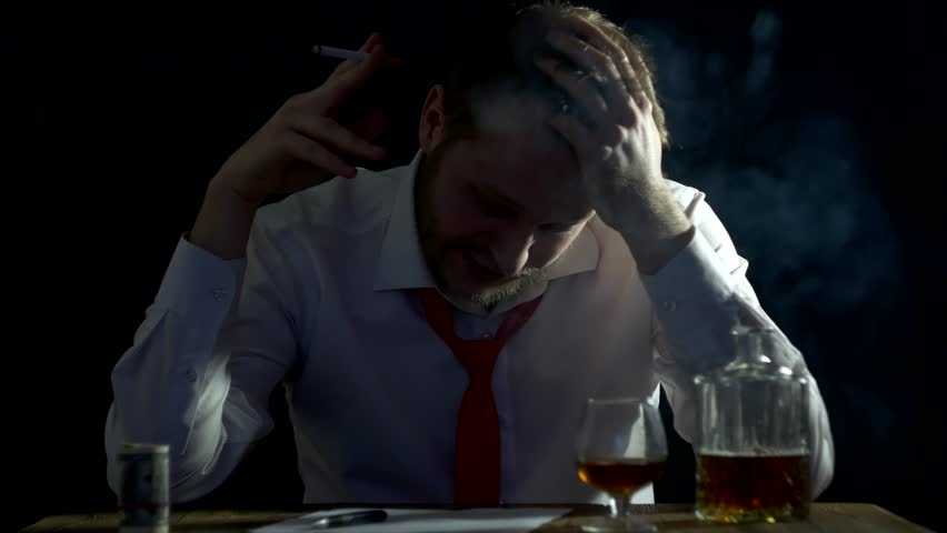 Bearded male businessman nervously smoking, nervous and doubting the signature of documents, business | Shutterstock HD Video #1019880538