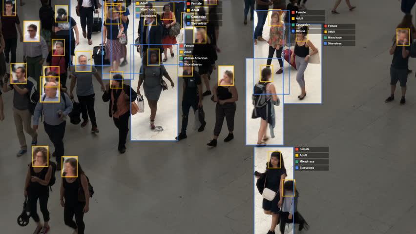 Crowded building with commuters walking. Artificial intelligence and facial recognition are used for surveillance purposes. Individual data showing sex, race and clothing. Deep learning. Futuristic. | Shutterstock HD Video #1020030868