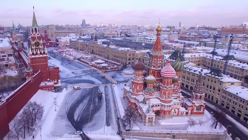 Unique aerial flight Red Square Moscow capital Russia. Winter snow holidays New Year celebration preparation. Saint Basil's Cathedral orthodox colorful church. Happy people walk. Day dramatic mood | Shutterstock HD Video #1020066478