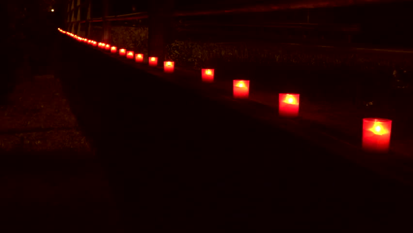 Burning candles on the Church churchyard along road  | Shutterstock HD Video #1020073198