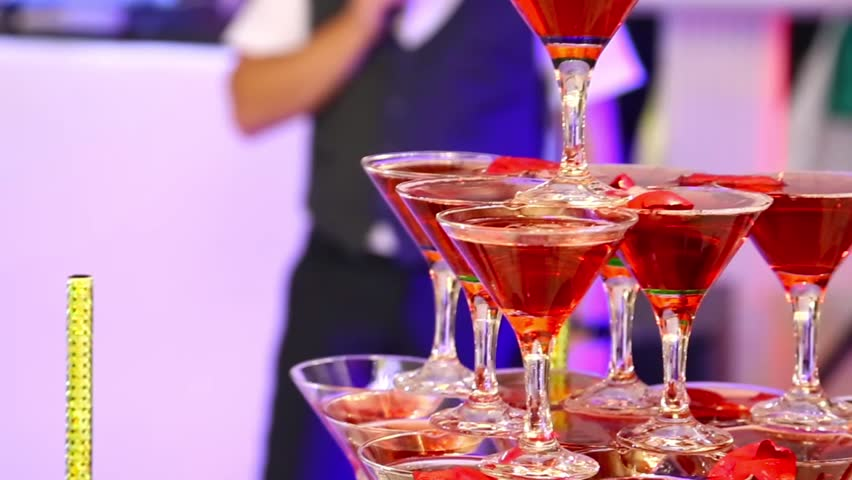 Pyramid of filled champagne glasses | Shutterstock HD Video #1020105628