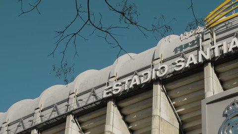 MADRID, SPAIN - JANUARY 17, 2018: Outside view of football stadium Santiago Bernabeu with Real Madrid logo. Home stadium of famous team