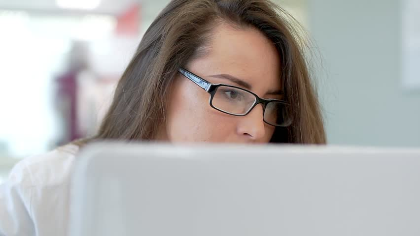 The girl in the workplace, looking at the monitor screen. | Shutterstock HD Video #1020193078