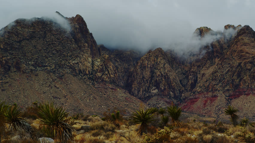 Low Level Storm Clouds Roil the Keystone Thrust of the Spring Mountains near Red Rock Canyon outside of Las Vegas | Shutterstock HD Video #1020244618