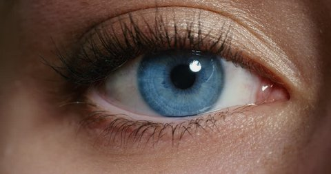 close up macro blue eye opening human iris natural beauty 4k footage shot on Red Epic Dragon