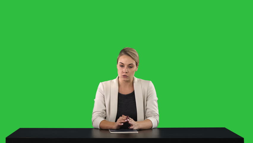 A female newsreader presenting the news, add your own text or image screen behind her on a Green Screen, Chroma Key. | Shutterstock HD Video #1020310318