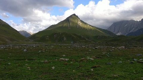 Time lapse of clouds over mountains with sunshine falling on the the peak during the Kashmir great lakes trek in Sonamarg, Jammu & Kashmir, India