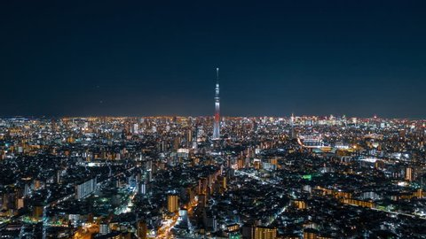 Tokyo Japan 15 Nov 2018 : Aerial night hyper lapse of Tokyo Skytree tower with Tokyo city in background.Tokyo Skytree is a broadcasting, restaurant and observation tower in Sumida Japan.