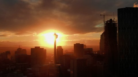 Aerial Drone Shot of Calgary Downtown Skyline at Sunset, Close up on Calgary Tower, Alberta Canada. Oil and Gas city.