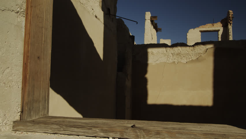 Shadows Cast Interesting Linear Patterns at the  Famous Cook Bank in Rhyolite, Nevada | Shutterstock HD Video #1020436438