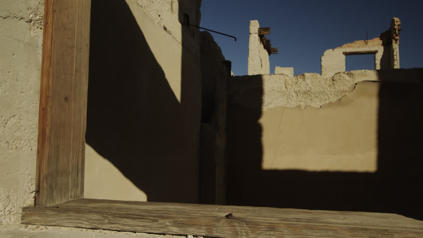Shadows  Cast Interesting Linear Patterns at the  Famous Cook Bank in Rhyolite, Nevada | Shutterstock HD Video #1020436528