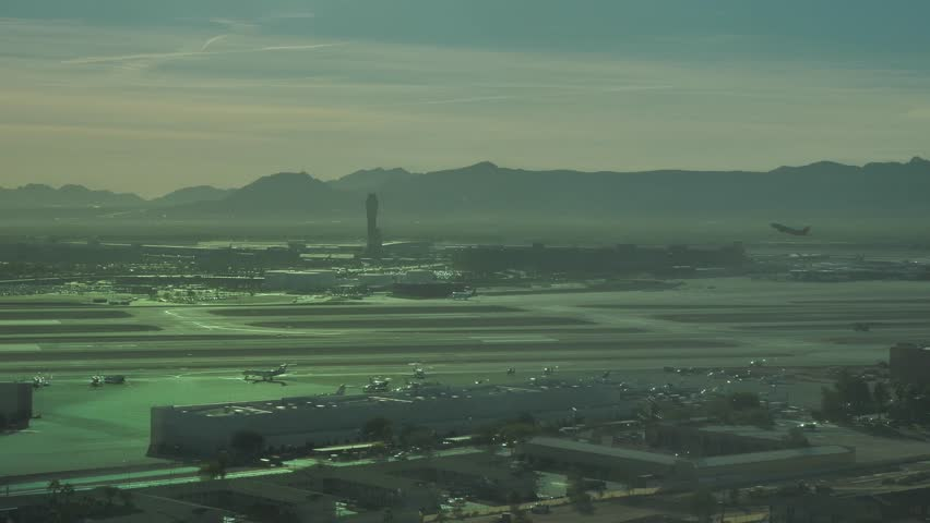 Airplane take off and fly over Las Vegas  | Shutterstock HD Video #1020444328