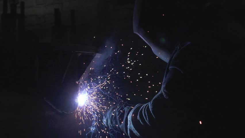 Professional Industrial worker welding at workshop in slow motion | Shutterstock HD Video #1020501808